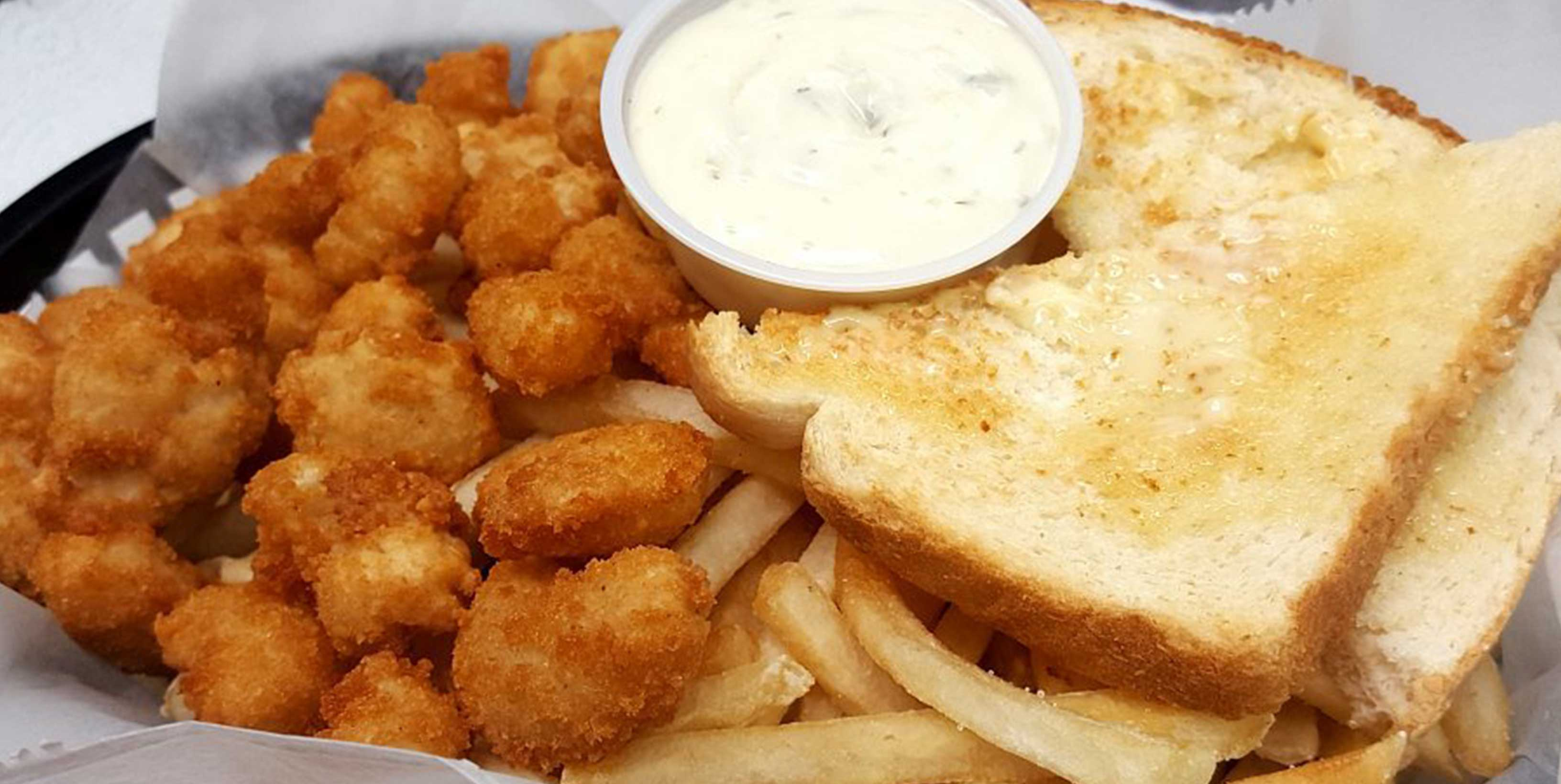Basket of cheese curds, French fries, and toast from Main Gate Bar & Grill